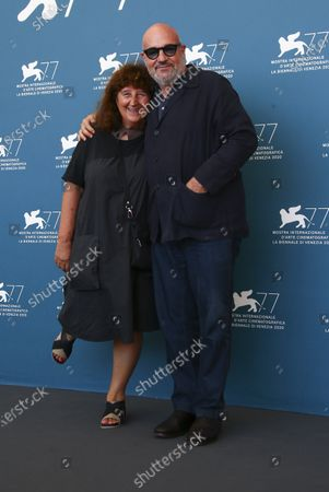 Producer Donatella Palermo, left, and director Gianfranco Rosi pose for photographers at the photo call for the film 'Notturno' during the 77th edition of the Venice Film Festival in Venice, Italy