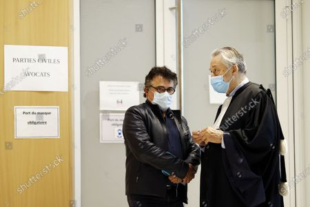 Stock Picture of French writer, activist and specialist of emergency medical services Patrick Pelloux (L) speaks with a lawyer as he attends the hearing of the witnesses to the Charlie Hebdo terror attacks at the courthouse in Paris, France, 08 September 2020. The Charlie Hebdo terror attack trial will be held from 02 September to 10 November 2020. The terrorist attacks in Paris happened on 07 January 2015, with the storming of armed Islamist extremists of the satirical newspaper, starting three days of terror in the French capital.