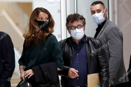 Moroccan journalist and writer Zineb El Rhazoui (L) and French writer, activist and specialist of emergency medical services Patrick Pelloux (R) attend the hearing of the witnesses to the Charlie Hebdo terror attacks at the courthouse in Paris, France, 08 September 2020. The Charlie Hebdo terror attack trial will be held from 02 September to 10 November 2020. The terrorist attacks in Paris happened on 07 January 2015, with the storming of armed Islamist extremists of the satirical newspaper, starting three days of terror in the French capital.