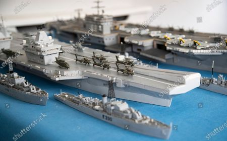 Tiny models of Apache attack helicopters, with spinning rotor blades, on the flight deck of Philip's matchstick model of HMS Queen Elizabeth.   A master modeller who has spent over 70 years building a fleet of 500 warships is having to scuttle his hobby - as he has run out of matchboxes.  Philip Warren's incredible matchstick navy consists of every class of Royal Navy ship since 1945.  Mr Warren, who was aged 17 when he first started his hobby, uses nothing but matchsticks, matchboxes, a razor blade and glue to handcraft the vessels.   The traditional boxes are made out of lightweight aspen wood which manufacturers ceased using in the 1980s in favour of cardboard.