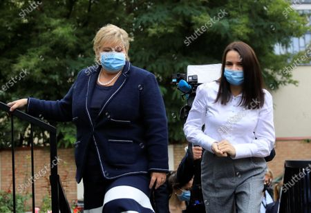 Norway's Prime Minister Erna Solberg (L) and Belarus' opposition leader Svetlana Tikhanovskaya (R) wear face masks as they talk to each other during their meeting at the Norwegian embassy in Vilnius, Lithuania, 08 September 2020. Erna Solberg is on a one day visit to Lithuania. Tikhanovskaya fled to Lithuania with her family following the Belarus presidential elections in which results claimed a landslide victory for president Lukashenko while opposition parties claim they were rigged. It was reported 07 Seprtember that Tikhanovskaya's fellow opposition campaigner Maria Kolesnikova, a representative of non-registered presidential candidate Victor Babariko, Kolesnikova has been detained by unidentified persons in Minsk.
