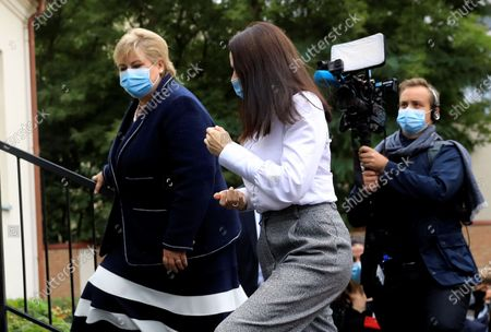 Norway's Prime Minister Erna Solberg (L) and Belarus' opposition leader Svetlana Tikhanovskaya (C) wear face masks as they talk to each other during their meeting at the Norwegian embassy in Vilnius, Lithuania, 08 September 2020. Erna Solberg is on a one day visit to Lithuania. Tikhanovskaya fled to Lithuania with her family following the Belarus presidential elections in which results claimed a landslide victory for president Lukashenko while opposition parties claim they were rigged. It was reported 07 Seprtember that Tikhanovskaya's fellow opposition campaigner Maria Kolesnikova, a representative of non-registered presidential candidate Victor Babariko, has been detained by unidentified persons in Minsk.