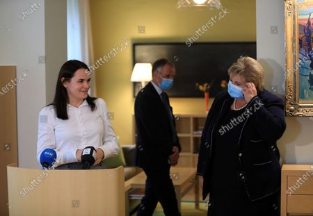 Norway's Prime Minister Erna Solberg (R) taks off her face mask as Belarus' opposition leader Svetlana Tikhanovskaya (L) speak to the media after their meeting at the Norwegian embassy in Vilnius, Lithuania, 08 September 2020. Erna Solberg is on a one day visit to Lithuania. Tikhanovskaya fled to Lithuania with her family following the Belarus presidential elections in which results claimed a landslide victory for president Lukashenko while opposition parties claim they were rigged. It was reported 07 Seprtember that Tikhanovskaya's fellow opposition campaigner Maria Kolesnikova, a representative of non-registered presidential candidate Victor Babariko, has been detained by unidentified persons in Minsk.