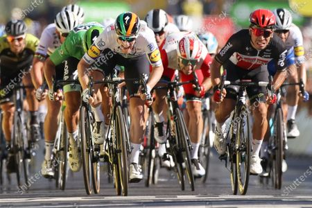 Ireland's Sam Bennett, center in white, crosses the finish line ahead of Slovakia's Peter Sagan, rear left, and Australia's Caleb Ewan, third place, second right, to win stage 10 of the Tour de France cycling race over 168.5 kilometers (104.7 miles) from Ile d'Oleron to Ile de Re, France