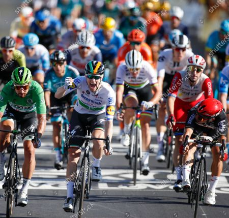 Ireland's Sam Bennett, center, crosses the finish line ahead of Slovakia's Peter Sagan, left, second place, and Australia's Caleb Ewan, right and third place, after winning stage 10 of the Tour de France cycling race over 168.5 kilometers (104.7 miles) from Ile d'Oleron to Ile de Re, France