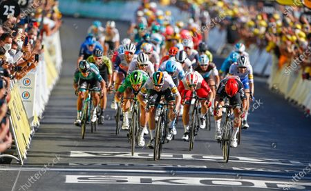 Ireland's Sam Bennett. center in white, crosses the finish line ahead of second place Australia's Caleb Ewan, right, and third place Slovakia's Peter Sagan, center left in green, to win stage 10 of the Tour de France cycling race over 168.5 kilometers (104.7 miles) from Ile d'Oleron to Ile de Re, France
