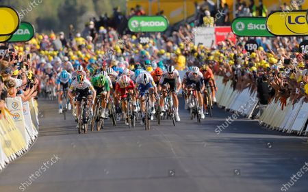 Ireland's Sam Bennett, far left in white, crosses the finish line ahead of third placed Slovakia's Peter Sagan, second left in green, to win stage 10 of the Tour de France cycling race over 168.5 kilometers (104.7 miles) from Ile d'Oleron to Ile de Re, France