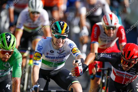 Ireland's Sam Bennett, center, is congratulated by Australia's Caleb Ewan, second place, right, as Slovakia's Peter Sagan, left, takes third place, after winning stage 10 of the Tour de France cycling race over 168.5 kilometers (104.7 miles) from Ile d'Oleron to Ile de Re, France