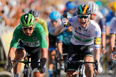 Ireland's Sam Bennett, right, celebrates as he crosses the finish line ahead of third place Slovakia's Peter Sagan, left, during stage 10 of the Tour de France cycling race over 168.5 kilometers (104.7 miles) from Ile d'Oleron to Ile de Re, France