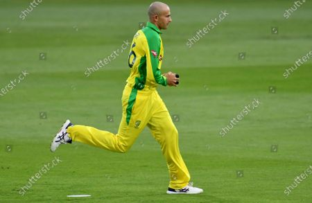 Australia's Ashton Agar celebrates after taking the catch to dismiss England's Jonny Bairstow during the third Twenty20 cricket match between England and Australia, at the Ageas Bowl in Southampton, England