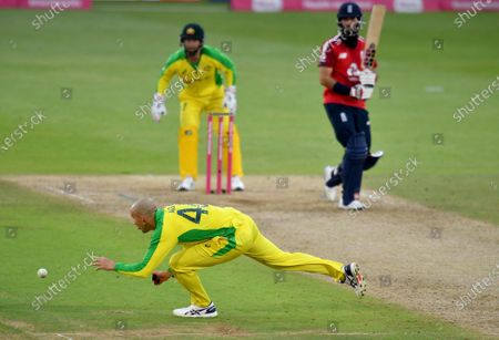 Australia's Ashton Agar, left, chases the ball after a shot played by England's captain Moeen Ali, right, during the third Twenty20 cricket match between England and Australia, at the Ageas Bowl in Southampton, England