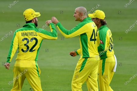Australia's Ashton Agar, center, celebrates with teammates after taking the catch to dismiss England's Jonny Bairstow during the third Twenty20 cricket match between England and Australia, at the Ageas Bowl in Southampton, England