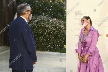 Director Ana Rocha, right converses with Venice film festival director Alberto Barbera whilst wearing clear protective masks upon arrival at the premiere of the film 'Listen' during the 77th edition of the Venice Film Festival in Venice, Italy, . The clear masks were used to draw attention to the difficulties deaf people, such as the character Maisie in the film, are having communicating in the current climate when face coverings are essential