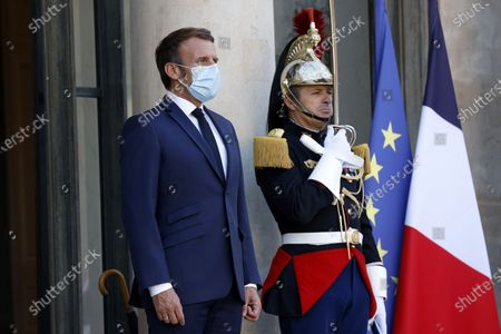 French President Emmanuel Macron waits for Jordan's King Abdullah II at the Elysee Palace in Paris, France, 08 September 2020.