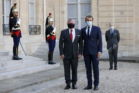 French President Emmanuel Macron (R) poses with Jordan's King Abdullah II (L) upon his arrival at the Elysee Palace in Paris, France, 08 September 2020.