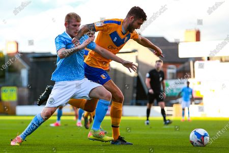 Stock Picture of Ryan Sweeney of Mansfield Town runs on the ball under pressure from Sammy Robinson of Manchester City