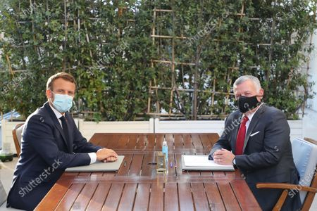 French President Emmanuel Macron (L) and Jordanian King Abdullah II, wearing face masks, pose during their meeting at the Elysee Palace in Paris, France, on 08 September 2020.