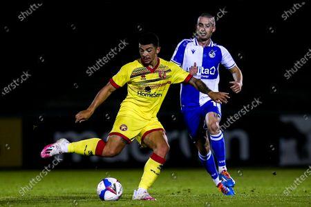 Josh Gordon of Walsall takes on Michael Kelly of Bristol Rovers