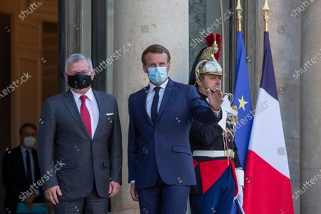 French President Emmanuel Macron and Jordan's King Abdullah II, left, before a working meeting at the Elysee Palace, Paris, France