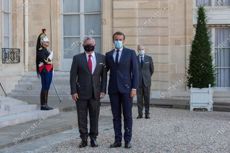 French President Emmanuel Macron, right, and Jordan's King Abdullah II pose before a working meeting at the Elysee Palace, Paris, France