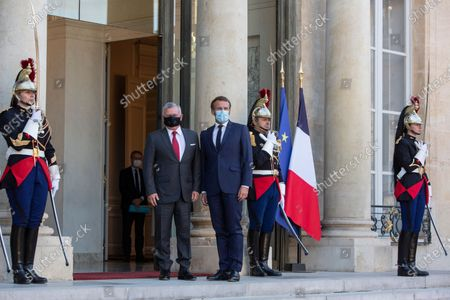 French President Emmanuel Macron, centre right, and Jordan's King Abdullah II pose together before a working meeting at the Elysee Palace, Paris, France