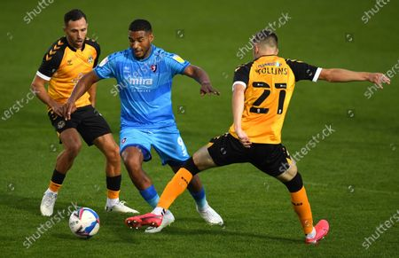 Stock Picture of Reuben Reid of Cheltenham Town is tackled by Lewis Collins of Newport County.