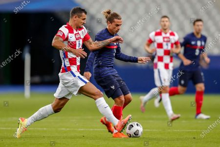 France's Antoine Griezmann, right, duels for the ball with Croatia's Dejan Lovren during their UEFA Nations League soccer match at the Stade de France stadium in Saint-Denis, north of Paris, France