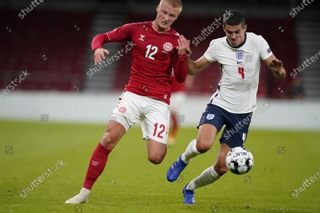Kasper Dolberg (L) of Denmark and England's Conor Coady in action during the UEFA Nations League soccer match between Denmark and England at Parken Stadium in Copenhagen, Denmark, 08 September 2020.