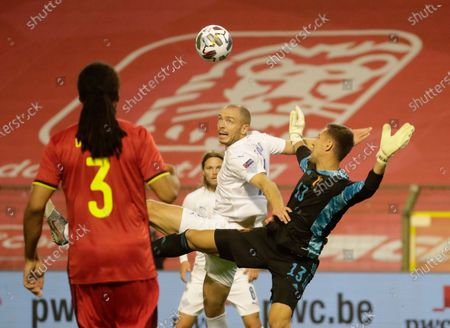 Stock Image of Belgium goalkeeper Koen Casteels (R) fights for the ball with Iceland player Emil Hallfredsson during Nations league soccer match Between Belgium and Iceland at King Baudouin stadium in Brussels, Belgium, 08 September 2020.