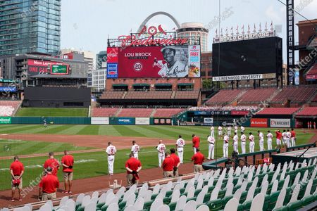 Members of the St. Louis Cardinals pause for a moment of silence in honor of former Cardinals great Lou Brock before the start of the first game of a baseball doubleheader against the Minnesota Twins, in St. Louis. Brock died Sunday, Sept. 6, 2020 at the age of 81
