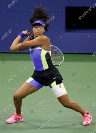 Naomi Osaka of Japan in action against Shelby Rogers of the USA during their match on the ninth day of the US Open Tennis Championships at the USTA National Tennis Center in Flushing Meadows, New York, USA, 08 September 2020. Due to the coronavirus pandemic, the US Open is being played without fans and runs from 31 August through 13 September.