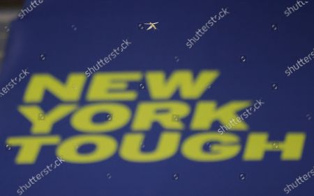 A Mantis bug is seen flying past a 'New York Tough' sign inside Arthur Ashe Stadium during the match between Naomi Osaka of Japan and Shelby Rogers of the USA on the ninth day of the US Open Tennis Championships at the USTA National Tennis Center in Flushing Meadows, New York, USA, 08 September 2020. Due to the coronavirus pandemic, the US Open is being played without fans and runs from 31 August through 13 September.
