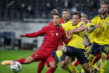 Sweden's Gustav Svensson (2L) in action against Portugal's Cristiano Ronaldo (L) during the UEFA Nations League match at Friends Arena, in Stockholm, Sweden, 08 September 2020.
