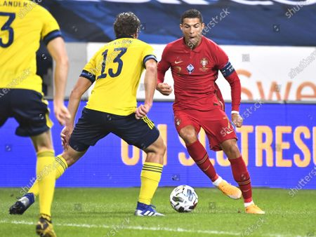 Sweden's Gustav Svensson (13) tries to stopp Christiano Ronaldo during the UEFA Nations League, division A, group 3 soccer game betwween Sweden and Portugal at Friends Arena in Stockholm, Sweden, 08 September 2020.