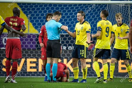Referee Danny Makkelie shows a red card to Sweden's Gustav Svensson (#13) during the UEFA Nations League, division A, group 3 soccer game betwween Sweden and Portugal at Friends Arena in Stockholm, Sweden, 08 September 2020.