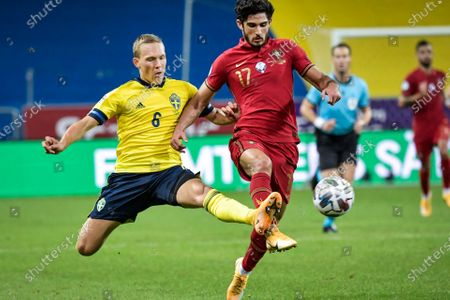 Sweden's Ludwig Augustinsson (L) and Portugal's Goncalo Guedes fight for the ball during the UEFA Nations League, division A, group 3 soccer game betwween Sweden and Portugal at Friends Arena in Stockholm, Sweden, 08 September 2020.