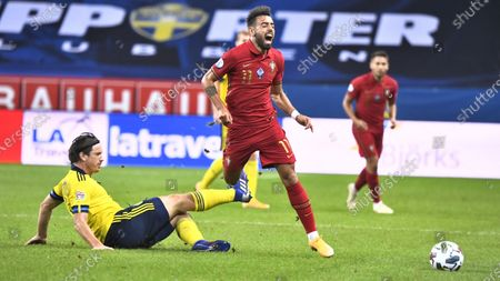 Sweden's Gustav Svensson battles for the ball with Portugal's Bruno Fernande during the UEFA Nations League, division A, group 3 soccer game betwween Sweden and Portugal at Friends Arena