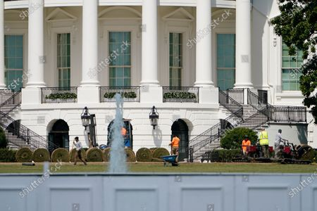 Workers lay sod on the South Lawn of the White House, in Washington. The White House South Lawn and its iconic Rose Garden are undergoing extensive re-sodding and other work after last month's Republican National Convention turned them into a muddy mess. Crews have been working to repair damage to the public grounds, including browning of the South Lawn and mud patches in the Rose Garden, after the spaces were used as backdrops for President Donald Trump's convention events