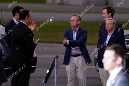 White House social media director Dan Scavino, from left, White House aide John McEntee former acting chief of staff Mick Mulvaney, White House adviser Jared Kushner and Sen. Lindsey Graham, R-S.C., talk as President Donald Trump speaks during a campaign rally at Smith Reynolds Airport, in Winston-Salem, N.C