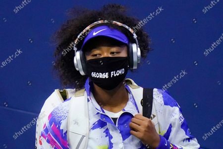 "Naomi Osaka, of Japan, wears a protective mask due to the COVID-19 virus outbreak, featuring the name ""George Floyd"", while arriving on court to face Shelby Rogers, of the United States, during the quarterfinal round of the US Open tennis championships, in New York"