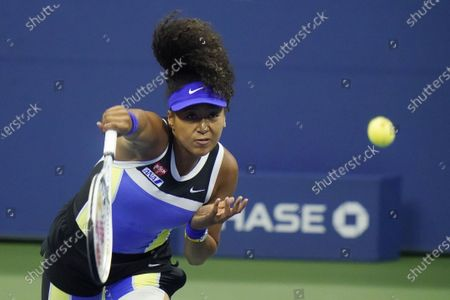 Naomi Osaka, of Japan, serves to Shelby Rogers, of the United States, during the quarterfinal round of the US Open tennis championships, in New York