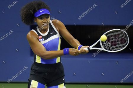 Naomi Osaka, of Japan, returns to Shelby Rogers, of the United States, during the quarterfinal round of the US Open tennis championships, in New York