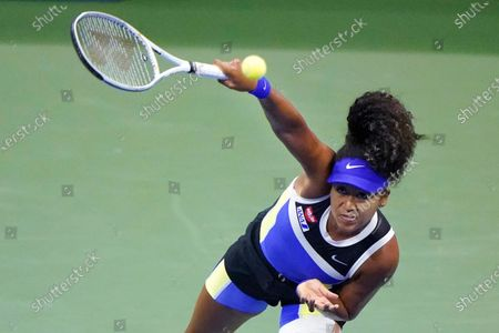 Stock Photo of Naomi Osaka, of Japan, serves to Shelby Rogers, of the United States, during the quarterfinal round of the US Open tennis championships, in New York