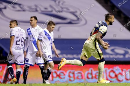 Stock Picture of Victor Manuel Aguilera (R) of America celebrates a goal against Puebla during a Mexican Soccer 2020 Guardianes tournament match at the Cuauhtemoc stadium in Puebla, Mexico, 08 September 2020.
