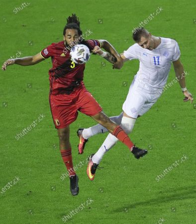 Belgium's Jason Denayer (L) and Iceland's Holmbert Fridjonsson vie for the ball during the UEFA Nations League football match between Belgium and Iceland at the King Baudouin Stadium in Brussels, Belgium, Sept. 8, 2020. Belgium won 5-1.