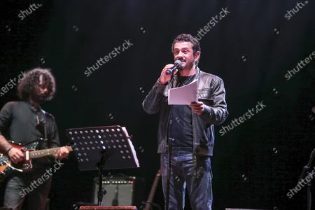 Stock Picture of The Muro del Canto in concert at the Cavea of the Parco della Musica with the participation of Vinicio Marchioni. Daniele Coccia Paifelman on vocals.