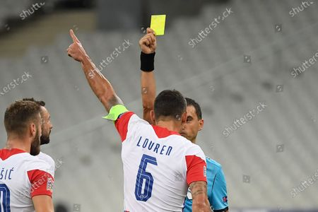 Dejan Lovren receive a yellow card during the UEFA Nations League Group C football match between France and Croatia on September 8, 2020 at the Stade de France in Saint-Denis, near Paris.