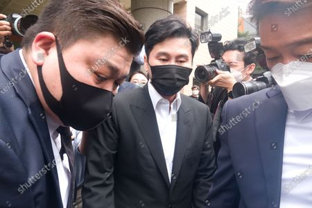 Yang Hyun-Suk, Sep 9, 2020 : Yang Hyun-Suk (C), the founder and former CEO of YG Entertainment, leaves after his trial at the Seoul Western District Court in Seoul, South Korea. Local media reported Yang admitted to charges that he gambled in casinos in Las Vegas in the U.S. over the past several years, during his first court hearing on the case. Yang and three others, including two co-CEOs of YG's affiliated music label YGX, are facing charges that they had gambled at Las Vegas casinos on some 20 occasions between 2015 and 2019 with combined gambling money of some 400 million won (US$336,785) at stake, according to local media. Yang stepped down as the CEO and the chief producer of YG Entertainment in June 2019.