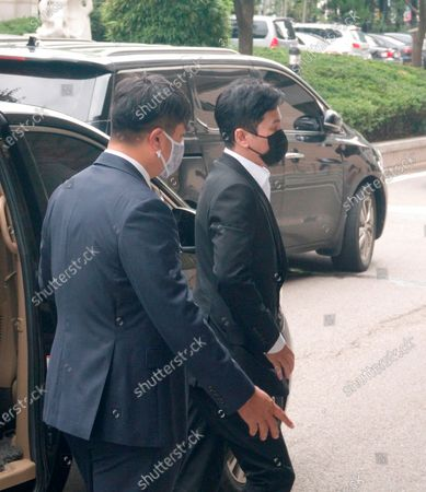 Yang Hyun-Suk, Sep 9, 2020 : Yang Hyun-Suk (R), the founder and former CEO of YG Entertainment, arrives for his trial at the Seoul Western District Court in Seoul, South Korea. Local media reported Yang admitted to charges that he gambled in casinos in Las Vegas in the U.S. over the past several years, during his first court hearing on the case. Yang and three others, including two co-CEOs of YG's affiliated music label YGX, are facing charges that they had gambled at Las Vegas casinos on some 20 occasions between 2015 and 2019 with combined gambling money of some 400 million won (US$336,785) at stake, according to local media. Yang stepped down as the CEO and the chief producer of YG Entertainment in June 2019.