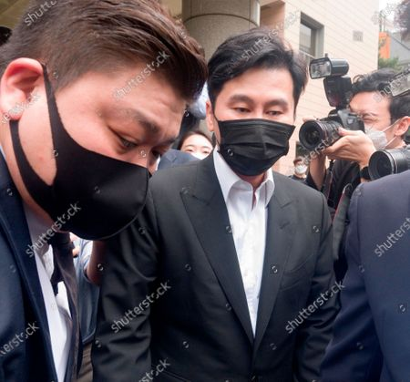 Stock Picture of Yang Hyun-Suk, Sep 9, 2020 : Yang Hyun-Suk (2nd L), the founder and former CEO of YG Entertainment, leaves after his trial at the Seoul Western District Court in Seoul, South Korea. Local media reported Yang admitted to charges that he gambled in casinos in Las Vegas in the U.S. over the past several years, during his first court hearing on the case. Yang and three others, including two co-CEOs of YG's affiliated music label YGX, are facing charges that they had gambled at Las Vegas casinos on some 20 occasions between 2015 and 2019 with combined gambling money of some 400 million won (US$336,785) at stake, according to local media. Yang stepped down as the CEO and the chief producer of YG Entertainment in June 2019.